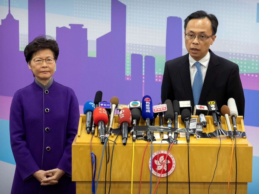 PHOTO: Patrick Nip, Hong Kongs Secretary for Constitutional and Mainland Affairs, speaks as Chief Executive Carrie Lam listens during a press conference in Beijing, Wednesday, Nov. 6, 2019. (AP Photo/Mark Schiefelbein)