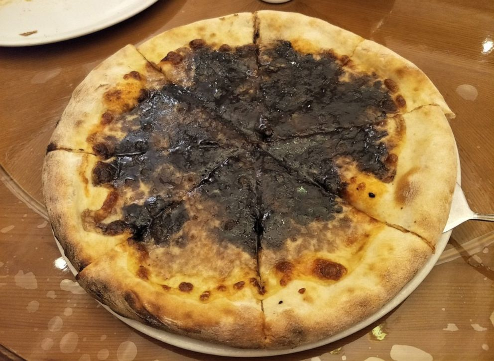 PHOTO: Chocolate pizza is served at the Italian cuisine specialty restaurant, Pyongyang, North Korea, June 19, 2019.