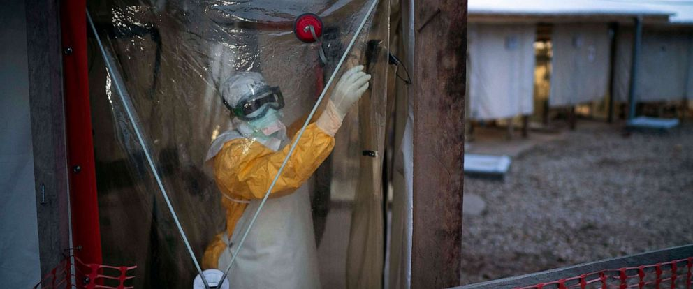PHOTO: A health worker wearing a protective suit enters an isolation pod to treat a patient at a treatment center in Beni, Congo DRC, July 13, 2019.