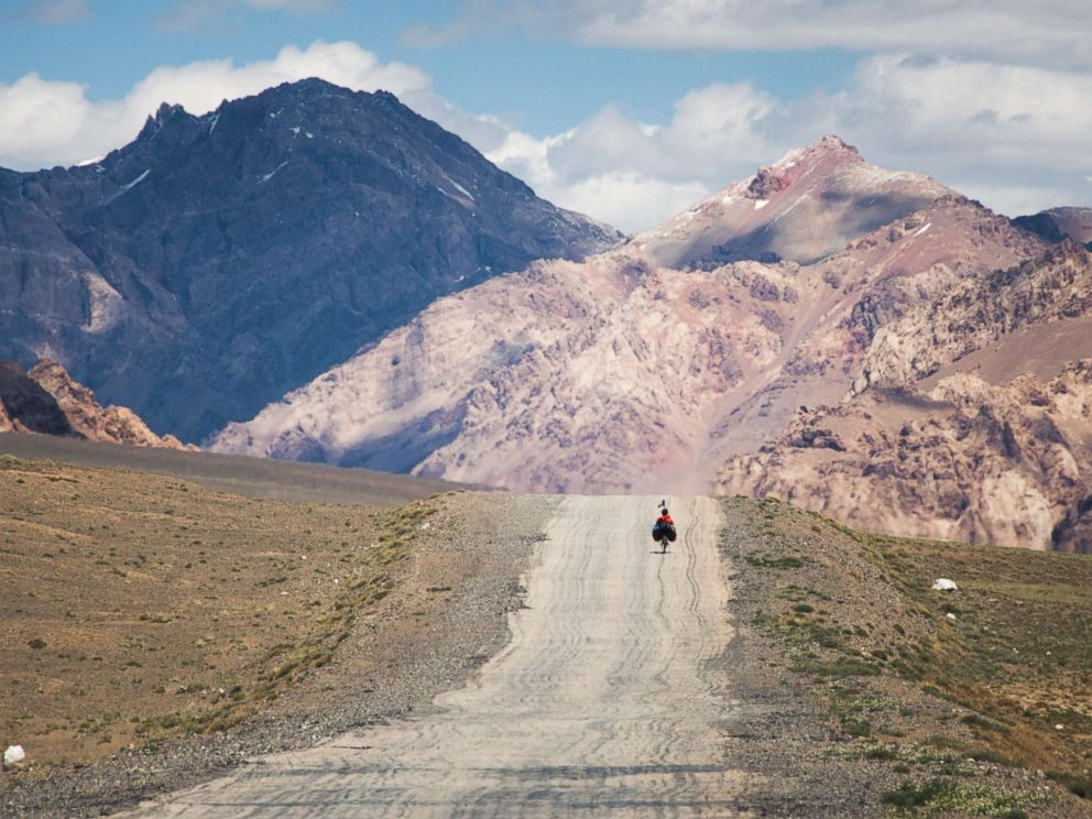 PHOTO: A traveler on the M41 road (also called Pamir highway), crossing the Pamir plateau in Tajikistan.