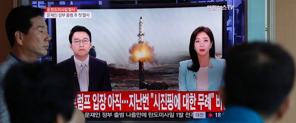 PHOTO: South Koreans watch a television displaying news broadcasts reporting on North Koreas recent ballistic missile launch, at a station in Seoul, South Korea, May 14, 2017.