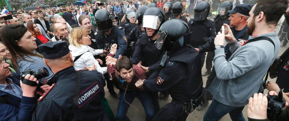 PHOTO: Police officers detain a participant of an anti-corruption rally in central St. Petersburg, Russia, June 12, 2017.