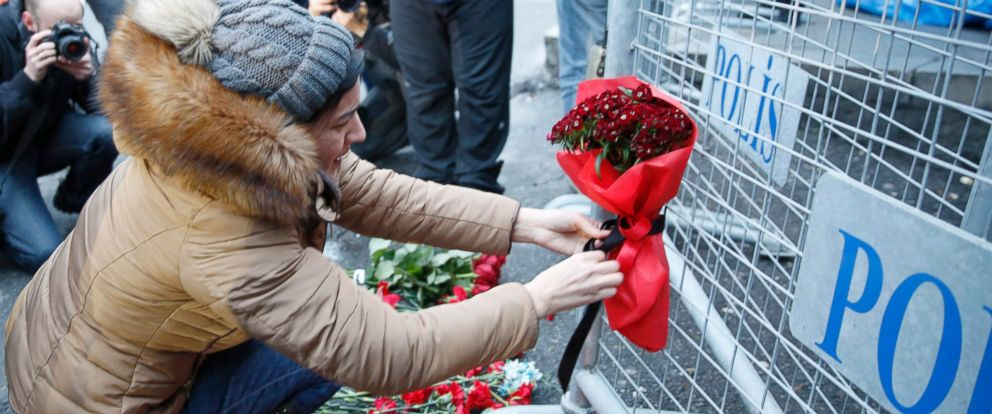 PHOTO: People place flowers and candles at a police barrier in front of the Reina night club, following a gun attack at the popular night club, in Istanbul, Turkey, Jan. 1, 2017.