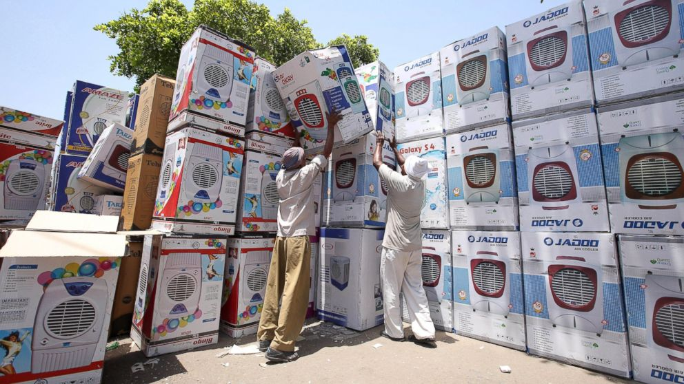 Indian laborers prepare air coolers for sale as temperature rises in New Delhi, May 27, 2015.