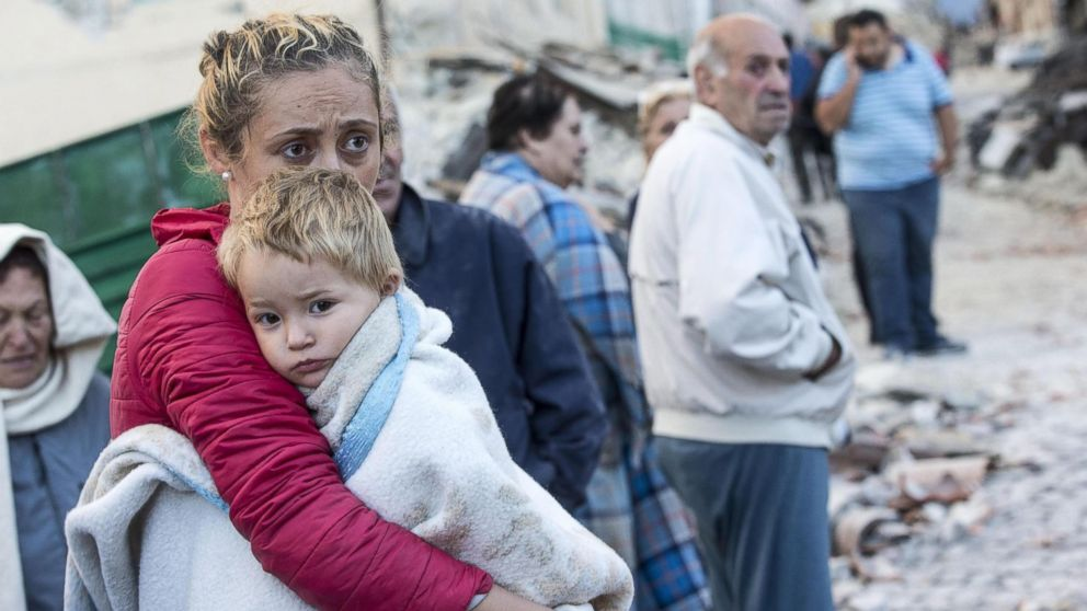 A mother embraces her son in Amatrice, Italy,  Aug. 24,  2016, following a earthquake.