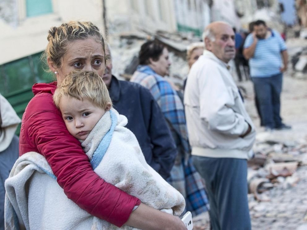 PHOTO: A mother embraces her son in Amatrice, Italy, Aug. 24, 2016, following a earthquake.