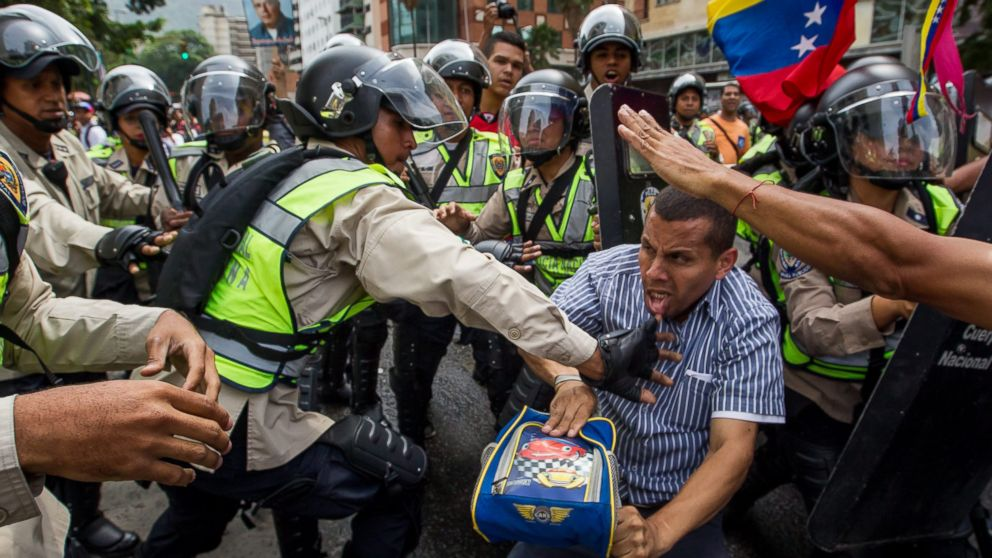 Demonstrators clash with police during a protest against Venezuelan President Nicolas Maduro's Government in Caracas, Venezuela, May 18, 2016.