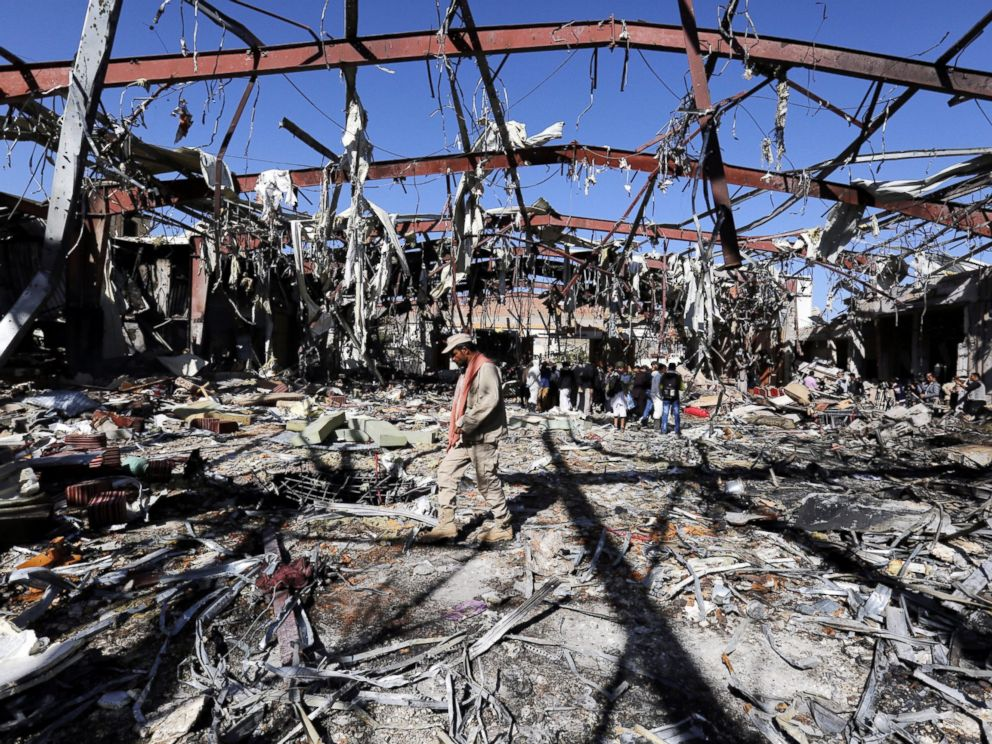 PHOTO: A militiaman patrols as Russian diplomats inspect the destroyed funeral hall, two days after an alleged Saudi-led airstrikes targeted it, in Sanaa, Yemen, Oct. 10, 2016.