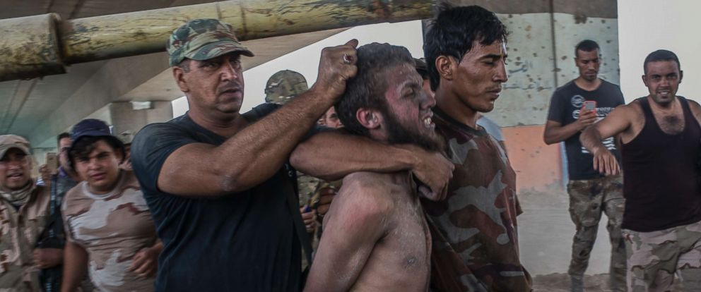 PHOTO: A man suspected of being an Islamic State militant is detained by the Iraqi Army on July 10, 2017 in Mosul, Iraq. Iraqi forces have declared victory but fighting continues as forces face fierce resistance from the desperate remaining IS militants.