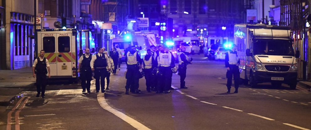 PHOTO: Police at the scene in Borough high street at London Bridge, on June 3, 2017, in London. Police have responded to reports of a van hitting pedestrians on London Bridge in central London.