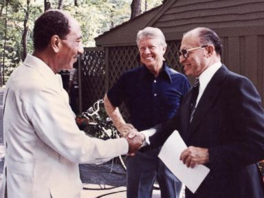 PHOTO: Egyptian President Anwar al-Sadat, left, shakes hands with Israeli Premier Menachem Begin, as President Jimmy Carter looks on September 6, 1978 at Camp David, the presidential retreat in Maryland.