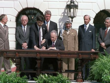 PHOTO: Israeli Foreign Minister Shimon Peres signs the agreement on Palestinian autonomy in the occupied territories on September 13, 1993 during a ceremony at the White House. This agreement came after months of secret talks in Oslo, Norway.