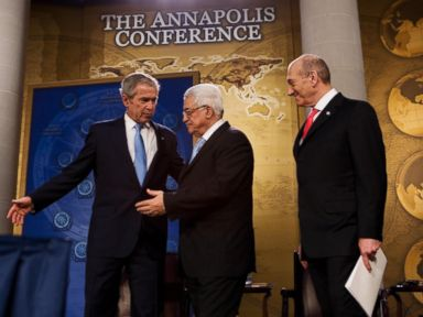 PHOTO: President George W. Bush, left, shows the way to Palestinian President Mahmud Abbas, center and Israeli Prime Minister Ehud Olmert after speaking November 27, 2007 during the Annapolis Conference at the US Naval Academy.