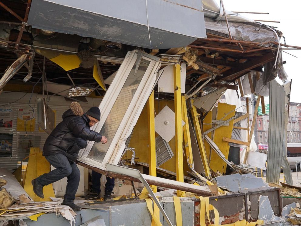 PHOTO: Muscovites inspect a demolished private trade pavilion on Feb. 9, 2016 in Moscow, Russia. Authorities have ordered 97 shopping centers, trade pavilions, street kiosks and stalls built without legal documentation near metro stations to be removed.