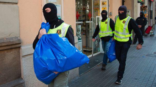 Spain arrests 9 suspected members of jihadi group in probe of Brussels attacks