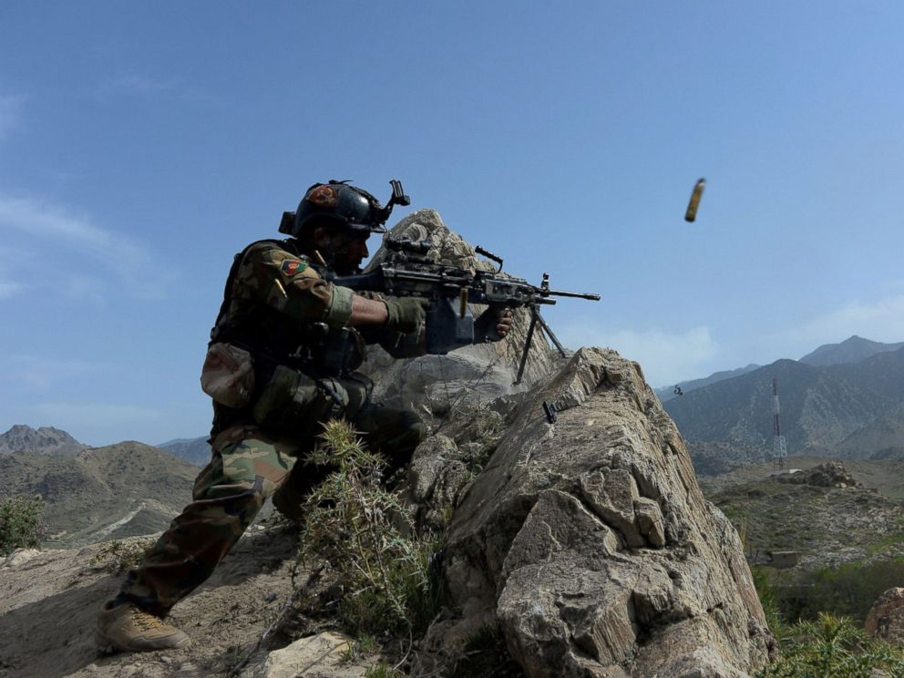 PHOTO: An Afghan security force personnel fires during an ongoing an operation against Islamic State (IS) militants in the Achin district of Nangarhar province, April 11, 2017.