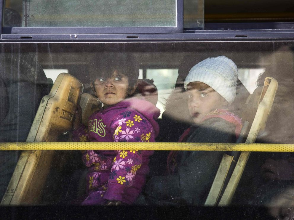 PHOTO: Children are seen inside a bus during an evacuation operation of rebel fighters and their families from rebel-held neighborhoods in Aleppo, Dec. 15, 2016.