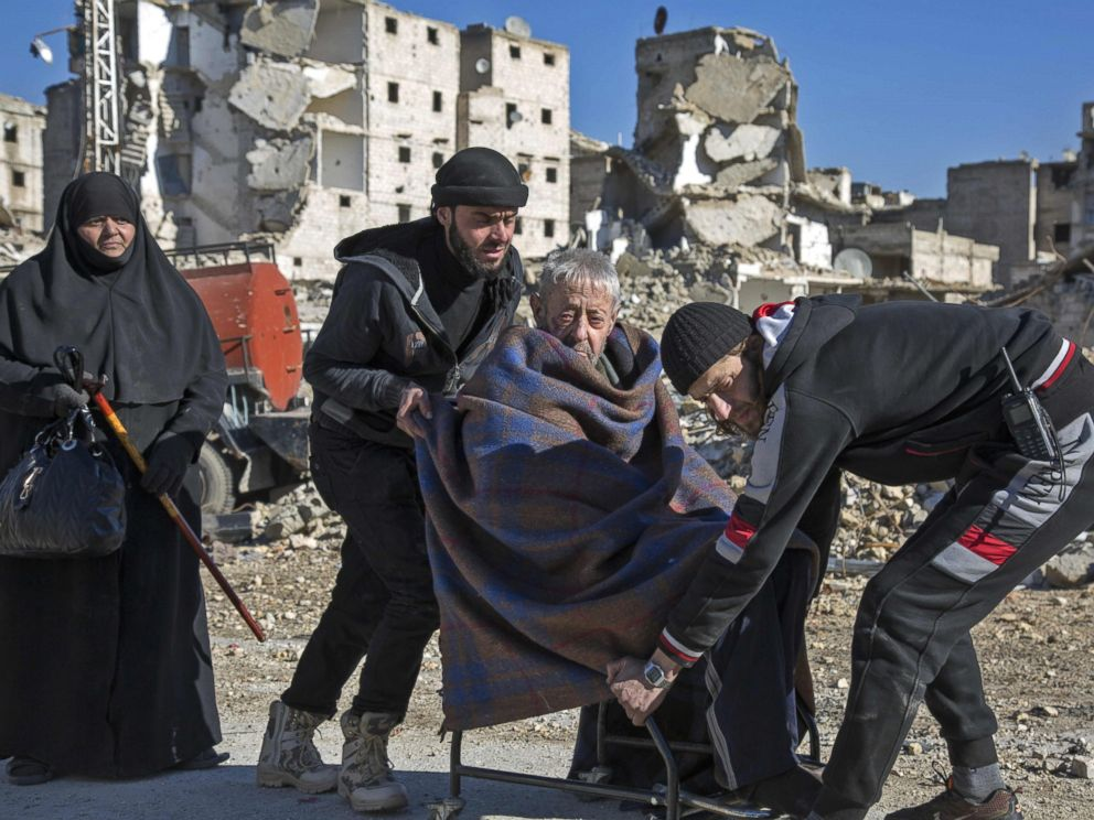 PHOTO: An elderly Syrian man is carried during an evacuation operation of rebel fighters and their families from rebel-held neighborhoods, Dec. 15, 2016 in Aleppo, Syria.