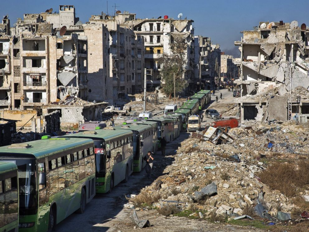 PHOTO: Buses are seen during an evacuation operation of rebel fighters and their families from rebel-held neighborhoods in Aleppo, Syria, Dec. 15, 2016.