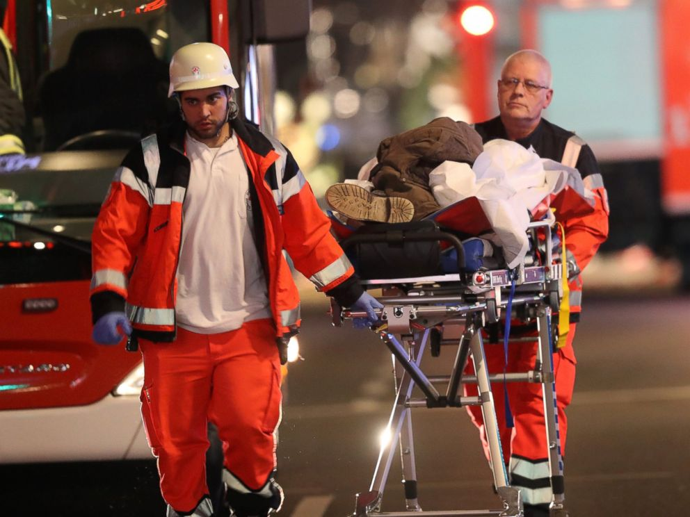 PHOTO: Rescue workers push a person on a stretcher in the area after a lorry truck ploughed through a Christmas market, Dec. 19, 2016, in Berlin.