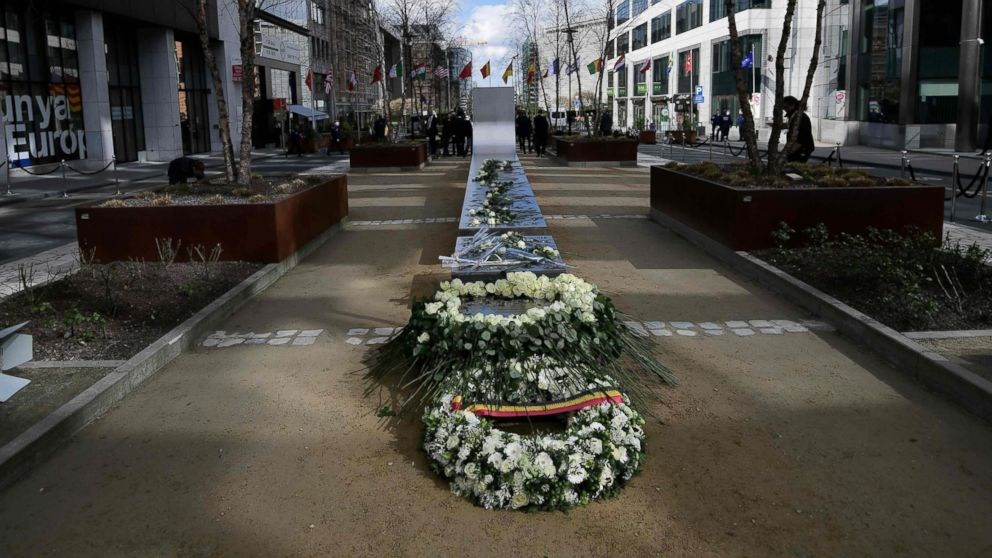 Wreaths are laid during the inauguration of a steel memorial by Belgian sculptor Jean-Henri Compere in Brussels as the country marks the first anniversary of the twin Brussels attacks, March 22, 2017.