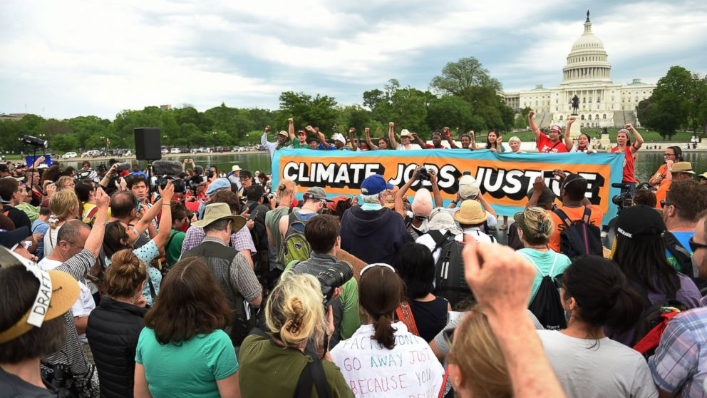 People gather near the U.S. Capitol for the People's Climate Movement before marching to the White House to protest President Donald Trump's environmental policies, April 29, 2017 in Washington, D.C.