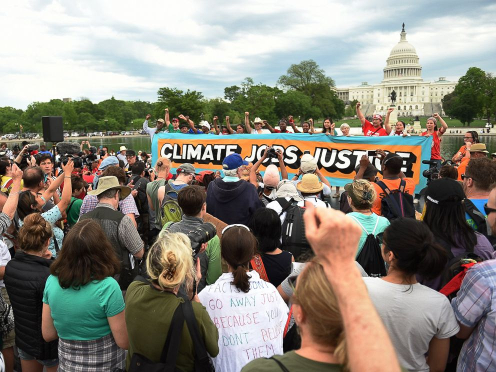 PHOTO: People gather near the U.S. Capitol for the Peoples Climate Movement before marching to the White House to protest President Donald Trumps environmental policies, April 29, 2017 in Washington, D.C.