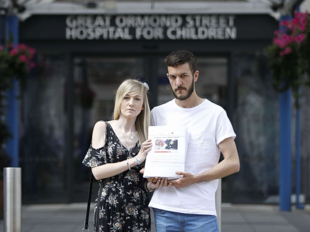 PHOTO: Connie Yates, left, and Chris Gard, parents of terminally-ill 10-month-old Charlie Gard, pose with a petition of signatures supporting their case, July 9, 2017.