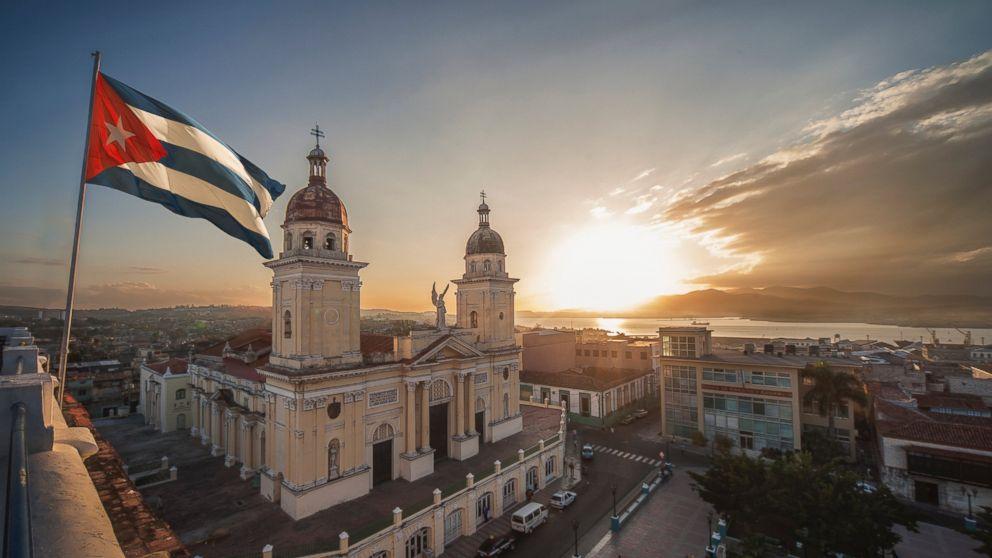 A Cuban flag is pictured over Plaza de la Cathdral in Santiago de Cuba, Cuba in this undated stock photo.