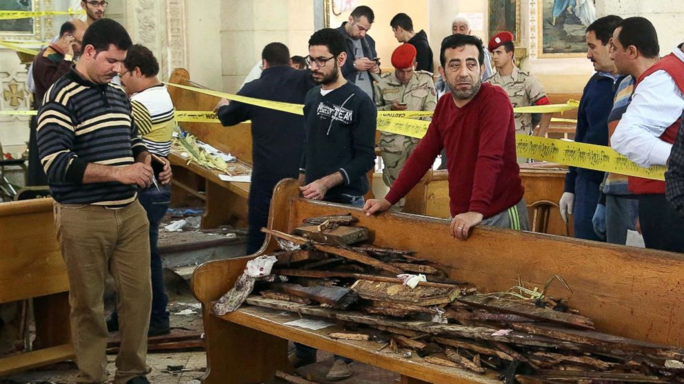A general view shows forensics collecting evidence at the site of a bomb blast which struck worshippers gathering to celebrate Palm Sunday at the Mar Girgis Coptic Church in the Nile Delta City of Tanta, 75 miles north of Cairo, April 9, 2017.