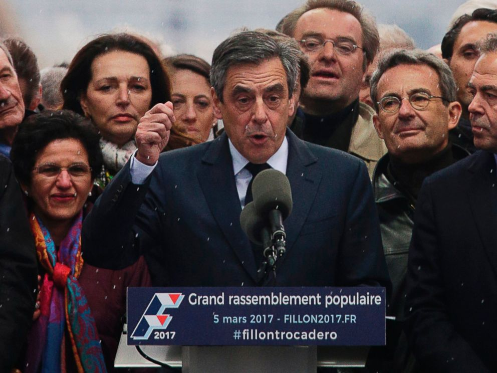 PHOTO: French presidential candidate for the right-wing Les Republicains party Francois Fillon, center, gestures as he delivers a speech on stage during a rally at the place du Trocadero, in Paris, March 5, 2017.