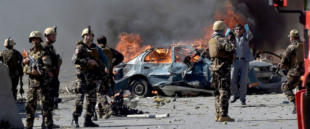 PHOTO: Afghan security forces personnel are seen at the site of a car bomb attack in Kabul, Afghanistan, May 31, 2017.