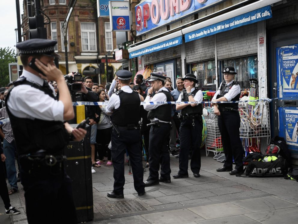 PHOTO: Police officers stand outside a property in East Ham which has been raided by police, June 4, 2017 in London, England.