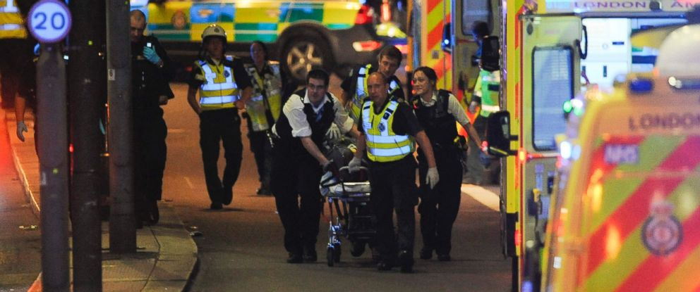 PHOTO: Police officers and members of the emergency services attend to a person injured in an apparent terror attack on London Bridge in central London on June 3, 2017.