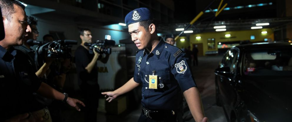 PHOTO: A Malaysian policeman tries to stop members of the media as a North Korean embassy official leaves the Forensic department at the Hospital Kuala Lumpur in Kuala Lumpur, Malaysia, Feb. 15, 2017.