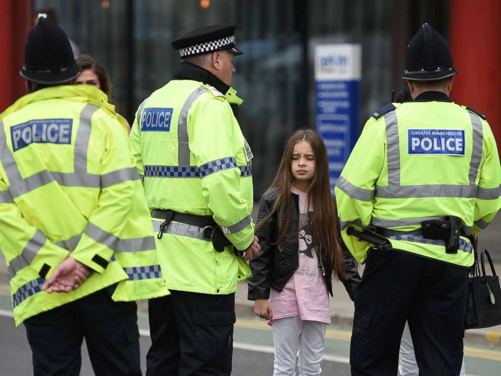 PHOTO: Police talk to people affected by the explosion at Manchester Arena in Manchester, England, May 23, 2017.