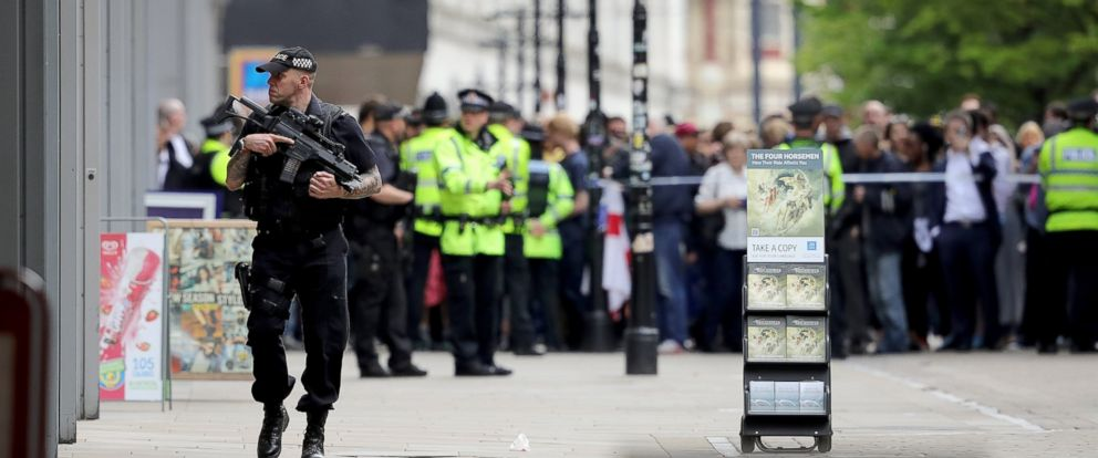 PHOTO: Crowds of people wait outside after police evacuated the Arndale Centre, May 23, 2017, in Manchester, England.