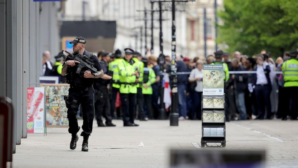 Crowds of people wait outside after police evacuated the Arndale Centre, May 23, 2017, in Manchester, England.