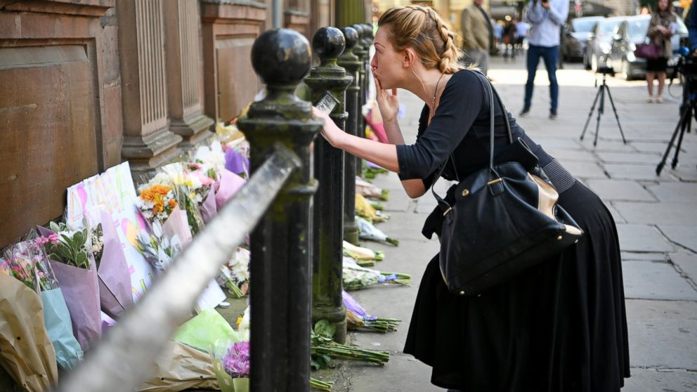 Members of the public lay flowers in St Ann Square, May 23, 2017, in Manchester, England.