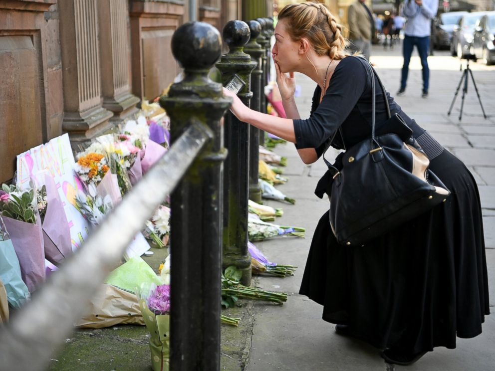 PHOTO: Members of the public lay flowers in St Ann Square, May 23, 2017, in Manchester, England.