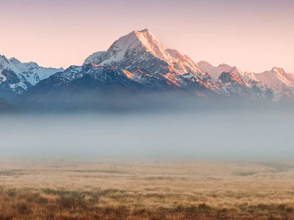 PHOTO: Mount Cooks (Aoraki) peak emerges from low mist at sunrise in Mt Cook National Park, Canterbury, South Island, New Zealand.