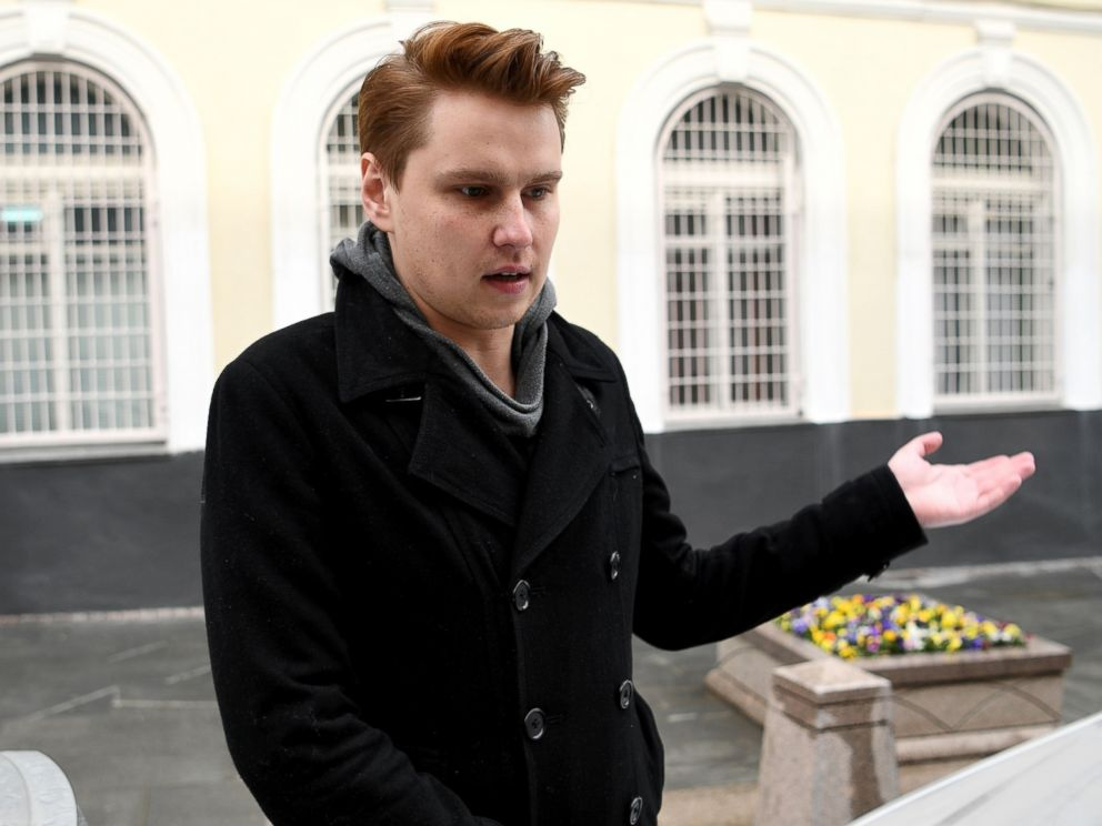 PHOTO: Russian gay rights activist Nikita Safronov gestures in front of the Tverskoe police department as he is released after being detained in central Moscow on May 11, 2017.