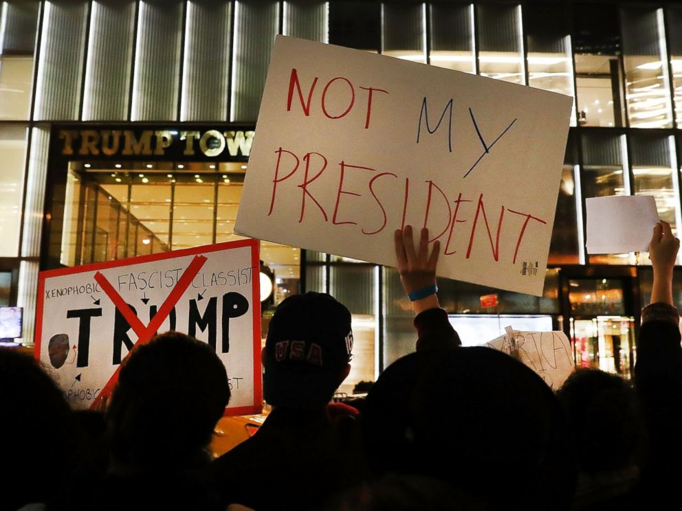 PHOTO: Dozens of anti-Donald Trump protesters stand along 5th Avenue in front of Trump Tower as New Yorkers react for a second night to the election of Trump as president of the United States, Nov. 10, 2016 in New York City.