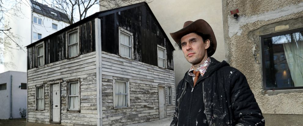 PHOTO: U.S. artist Ryan Mendoza poses for a photo next to the former house of Rosa Parks on Mendozas property, April 6, 2017, in Berlin.