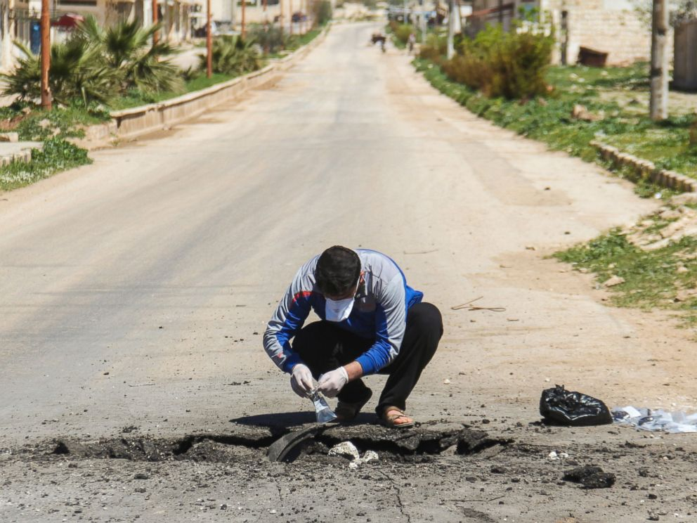 PHOTO: A Syrian man collects samples from the site of a suspected toxic gas attack in Khan Sheikhun, in Syrias Idlib province, April 5, 2017.