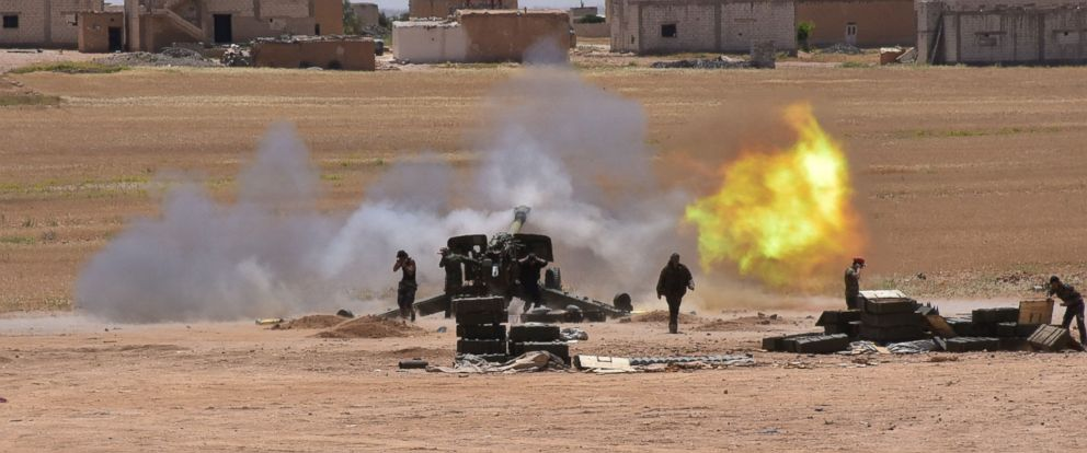 PHOTO: Syrian government forces fire artillery during a battle against the Islamic State group, May 16, 2017, in the town of Maskana, on the edge of Lake Assad in the eastern part of the Aleppo province.