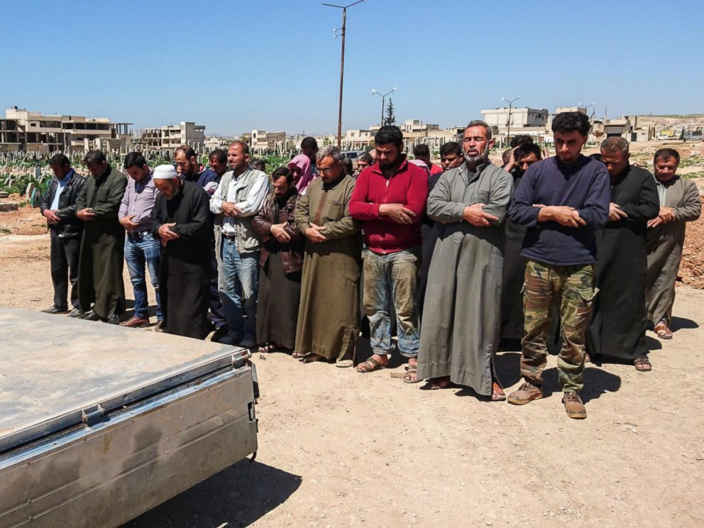 PHOTO: Syrians hold funeral prayers before they bury the bodies of victims of a a suspected toxic gas attack in Khan Sheikhun, a rebel-held town in Syrias Idlib province, April 5, 2017.