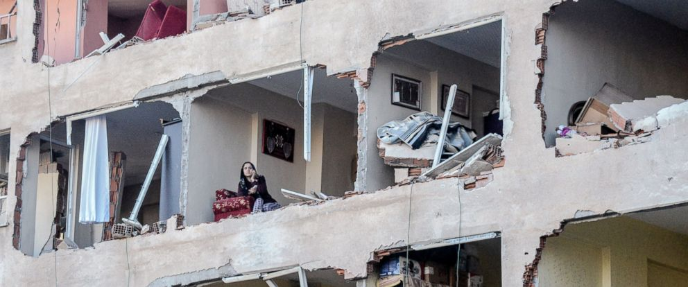 PHOTO: A woman sits in her damaged apartment on the explosion site, Nov. 4, 2016, after a strong blast in the southeastern Turkish city of Diyarbakir.