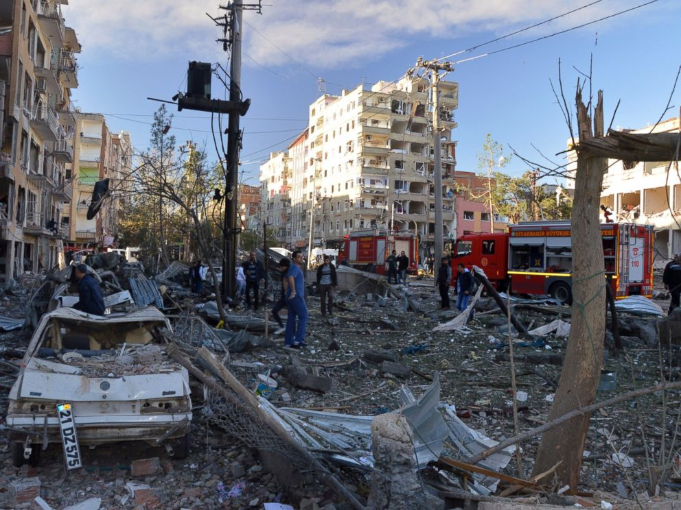 PHOTO: People watch the damage after an explosion in southeastern Turkish city of Diyarbakir, Nov. 4, 2016.