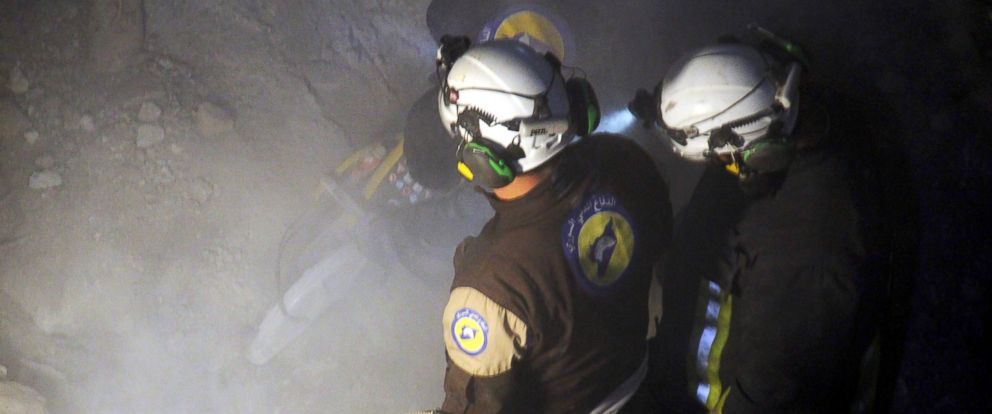 PHOTO: Syrian civil defence volunteers, known as the White Helmets, dig through the rubble of a mosque following a reported airstrike in the village of Al-Jineh in Aleppo province, March 16, 2017.